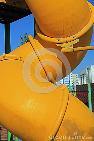 Free Close Up Of A Twisted Yellow Tube Slide Stock Photography - 50694422