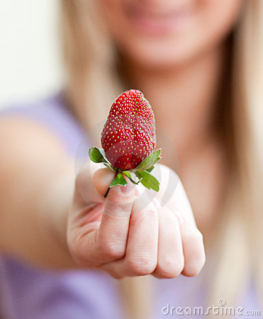 Free Close-up Of A Woman Showing A Strawberry Stock Images - 13766904