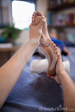 Free Close-up Of Boy Receiving Foot Massage From Young Female Therapist Stock Images - 96124584