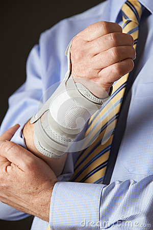 Free Close Up Of Businessman Suffering With Repetitive Strain Injury Stock Photography - 65615912