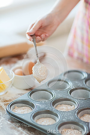 Free Close Up Of Hand Filling Muffins Molds With Dough Stock Photo - 38526000