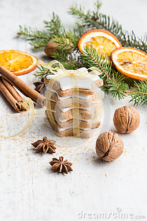 Free Close Up Of Homemade Butter Nuts Star Shaped Cookies With Icing, Pine, Orange Slices,cinnamon, Anise, Walnuts And Golden Ribbon Ov Stock Image - 78032321