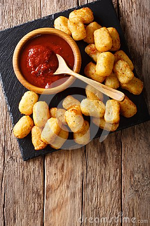 Free Close Up Of Rustic Golden Potato Tater Tots And Ketchup. Vertica Stock Photo - 104458260