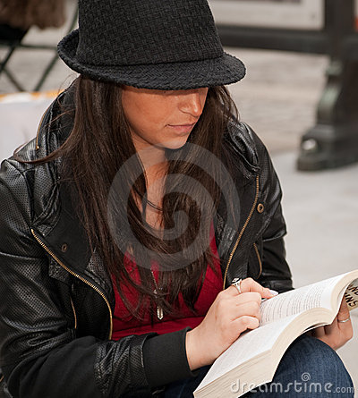 Free Close Up Of Urban Woman Reading In City Stock Photo - 15673720