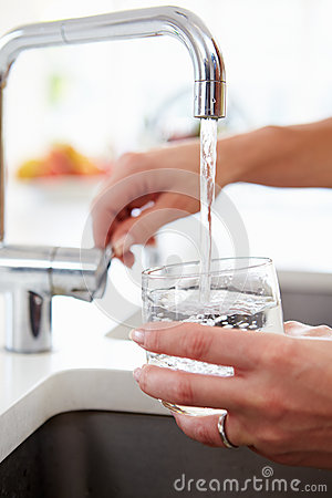 Free Close Up Of Woman Pouring Glass Of Water From Tap In Kitchen Stock Image - 34170031