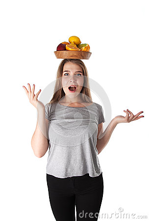 Free Close Up Of Young Surprised Woman Which Is Holding A Wooden Bowl With Fruits: Apples, Oranges, Lemon. Vitamins And Healthy Eating. Stock Photos - 94451223