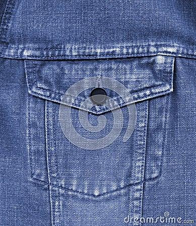 Close-up of old blue jeans pocket