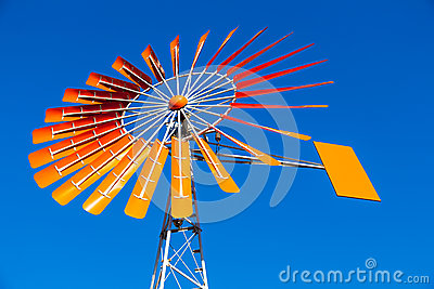 Orange Windmill Against a Blue Sky