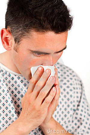 Close-up of a patient sneezing