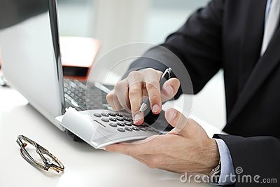Close-up photo of a businessman analyzing financial data