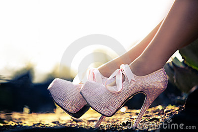 Close up of a pink high heels with diamonds