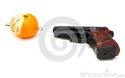 The close up of a pistol a tangerine