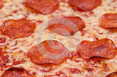 Close up of pizza with salami sausage