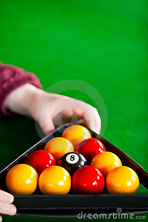 Close-up of a player placing billiard balls