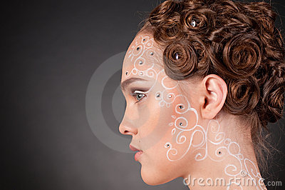 Close up portrait of beautiful girl with face art