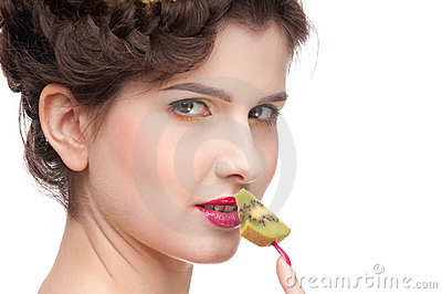Close up portrait of beauty woman with kiwi