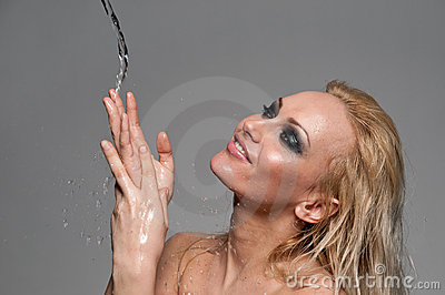 Close up portrait of blond woman play with water