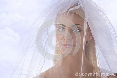 Close-up portrait of bride with veil on the face