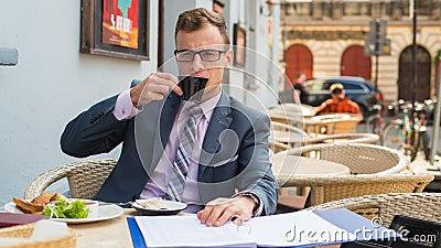 A close-up portrait of a businessman having breakfast.