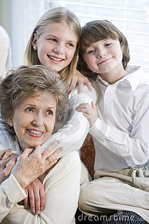 Close up portrait of children with grandmother