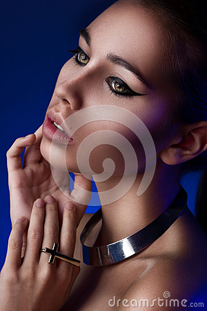 Close-up portrait of girl in blue light