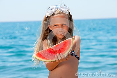 Close up portrait of girl eating watermelon.