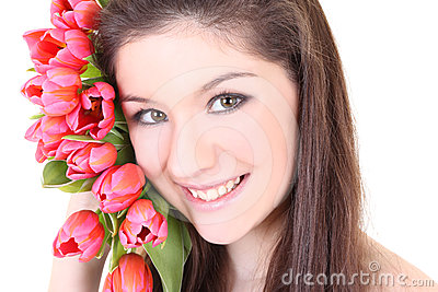Close-up portrait of girl with pink tulips