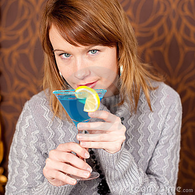 Close up portrait of gorgeous girl with cocktail