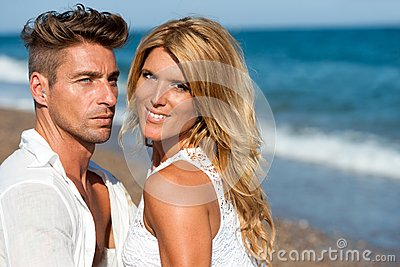 Close up portrait of handsome couple on beach.