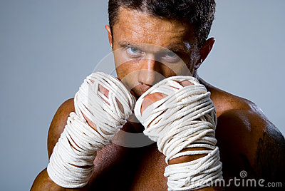 Close-up portrait of a kick-boxer in a fighting stance