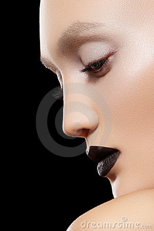Close-up portrait. Make-up trend, rock black lips