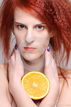 Close up portrait of redhaired woman with orange half