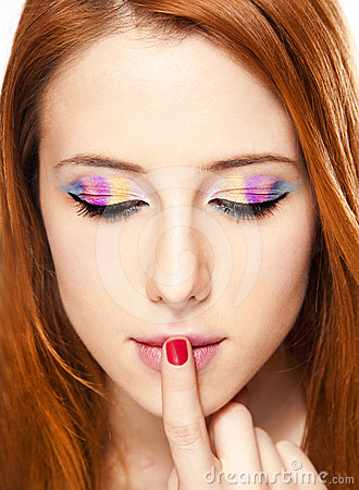 Close-up portrait of redhead girl with make-up.