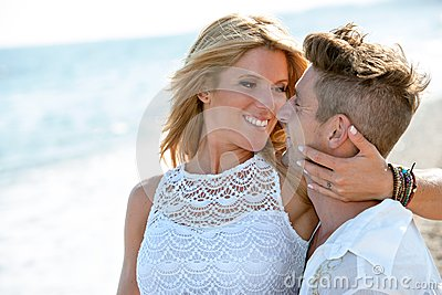 Close up portrait of romantic couple on beach.