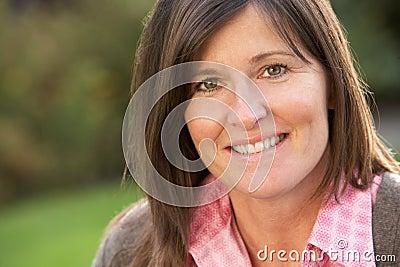 Close Up Portrait Of Smiling Brunette Woman