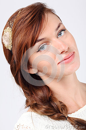 Close-up portrait of smiling young caucasian woman
