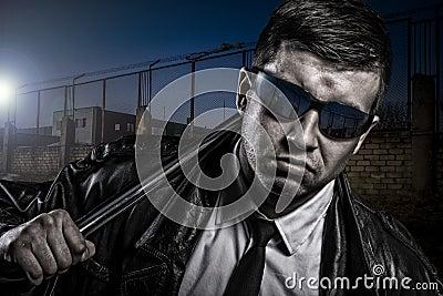 Close up portrait of stylish secret dangerous man with steel baton