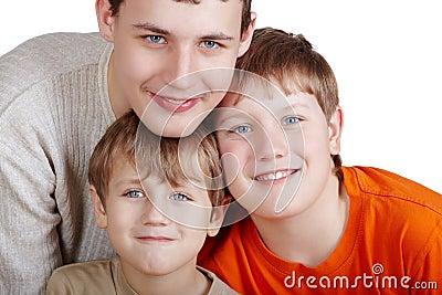 Close-up portrait of three smiling boys