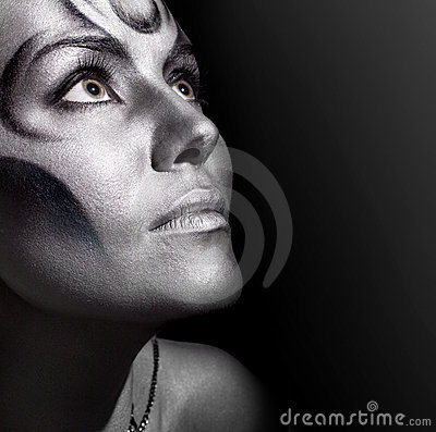 Close-up portrait woman with silver bodyart