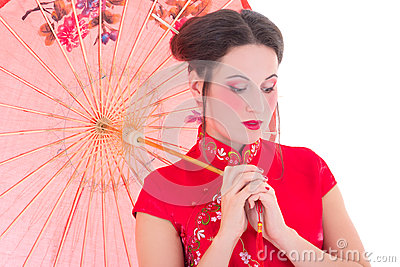 Close up portrait of young attractive woman in red japanese dres