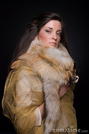 Close up portrait of young fashion woman in fur
