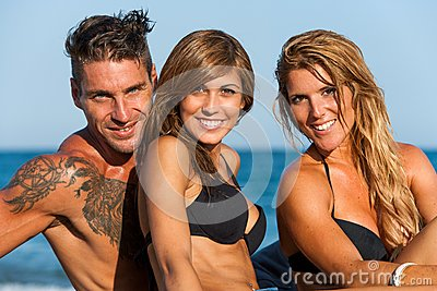 Close up portrait of young group on beach.