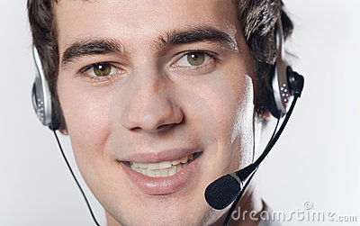 Close-up portrait of young smiling business man with headset
