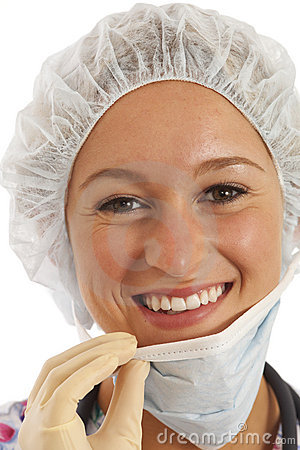 Close-up portrait of young woman nurse in scrubs