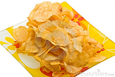 Close-up potato chips on plate isolated on white