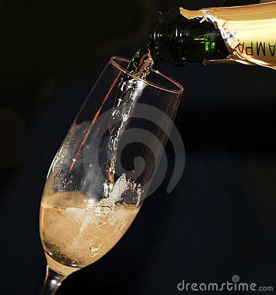 Close up of pouring champagne