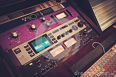 close up professional audio equipment with sliders and knobs at recording studio stock photo. Black Bedroom Furniture Sets. Home Design Ideas