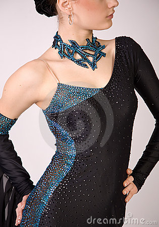 Close-up of professional dancer in beautiful dress