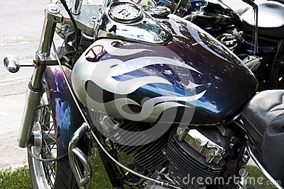 Close up of purple and silver custom motorcycle