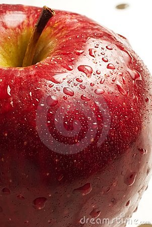Close up red apple with water droplets